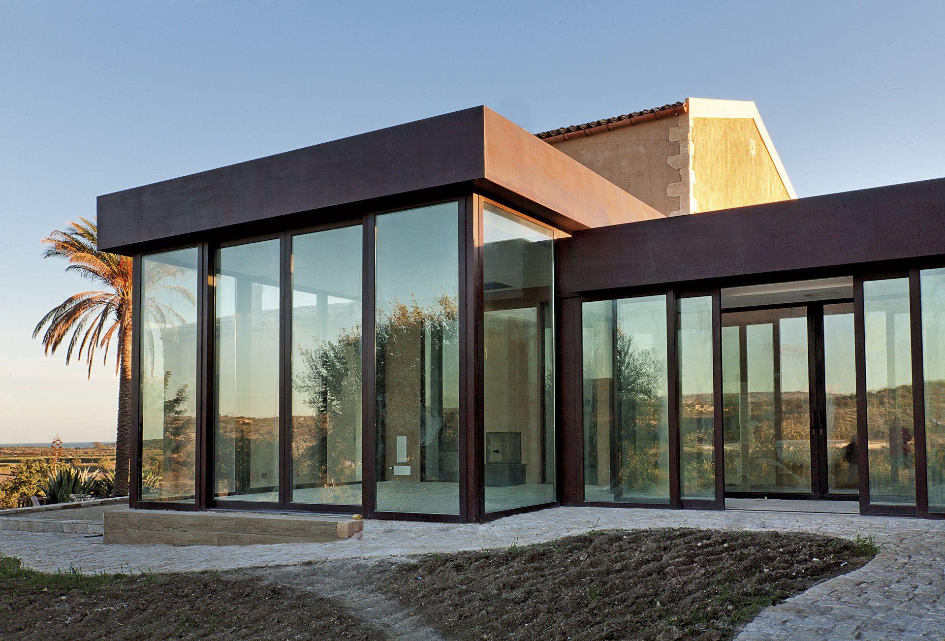 Giardino duinverno in acciaio corten with giardini d for Galimberti case legno